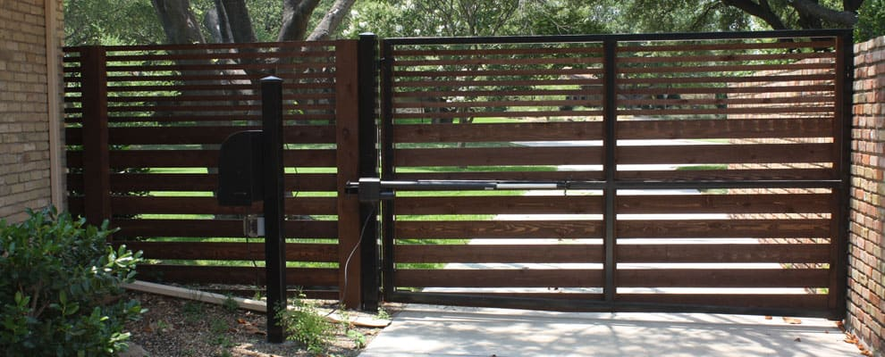 Built Dark Wooden Colour Gate Fence Around Lucas