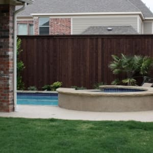 Wooden Fence Near Garden With Pool